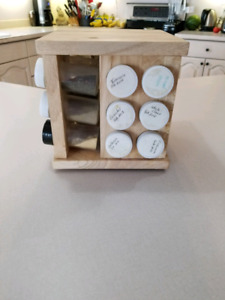 Wooden spice rack with some spices