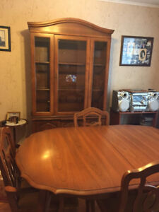A solid wood dining table, 4 chairs, china cabinet