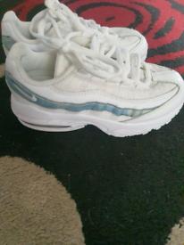 3 pairs of girls trainers