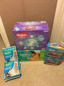 1 brand new box of huggies size 4 also pampers size 4