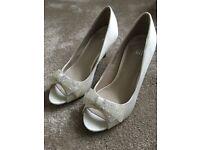 Ivory shoes size 3