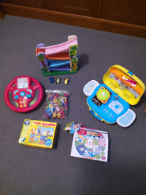 Bundle of toys cooker, CD player,steering wheel, Dolls, phones, puzzle