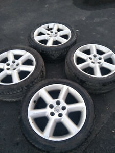 18 in. original NISSAN mags good condition (without tires)