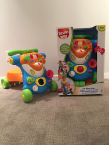 Brand New in Box! Child Walker and ride on toy in one.