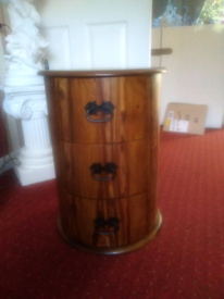 Round wooden chest with 3 drawers