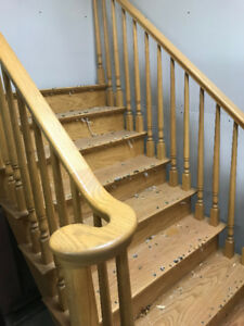 Oak stair case stairs have curved railing ends