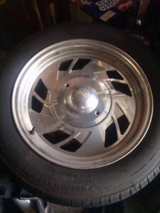 "for sale 5x127 chrome centerline rims 17""and tires."