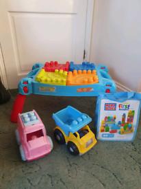 Mega blocks tableand trucks and extra blocks