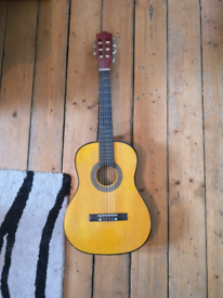 Small guitar with soft case