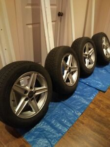 Aluminum 15 inch rims for a Volvo V 70