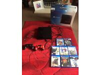Sony ps4 + 8 games 2 controllers