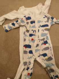 2 marks and Spencer sleepsuits