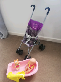 Child's doll buggy with bath and dolls