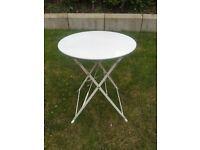 White metal foldable table.