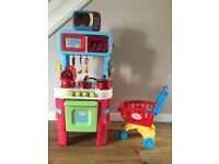 Early Learning Centre Play Kitchen + microwave+ trolley+bascets+hoover +play food