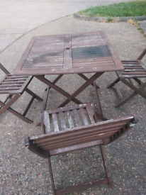 2 garden tables and 5 chairs