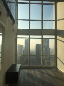 rare 2 story loft in downtown core on 30+flr with stunning views
