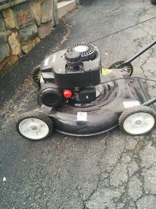 ALMOST NEW LAWN MOWER