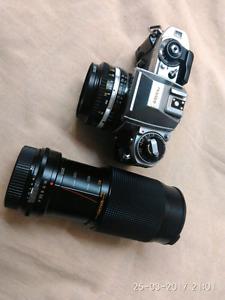 Nikon FG two lenses + unused Flash andd Bag (on hold till 6 pm)