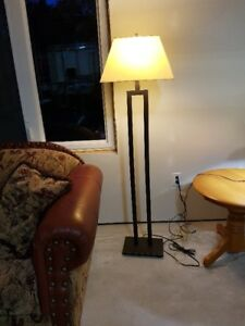 Burnished black/bronze floor lamp.