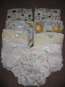 Kushies water proof diaper wrap and 8 diapers- NEW