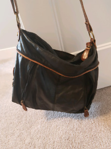 Black and brown purse, lots of pockets and zippers