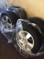 235/60/16 x 4 SNOW TIRES FOR SALE