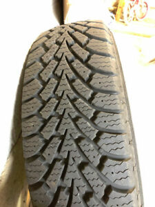 Four winter tires mounted steel rims 4 bolt pattern 185 65/R14