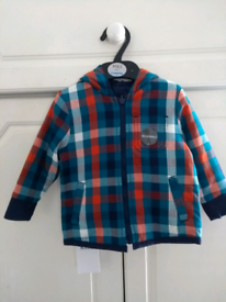 A bundle of baby boys clothes