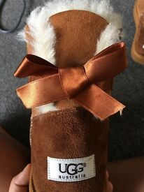 Size 6.5 tan short ugg boots with bows!