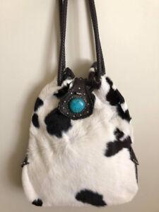 Magnifique sac à main en peau de vache véritable