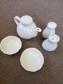 Set of condiments jars and plates