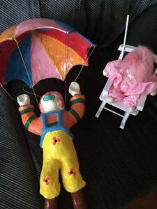Papier-mâché clown mobile and clown in rocking chair