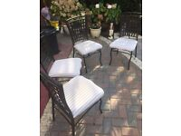 Four metal frame chairs