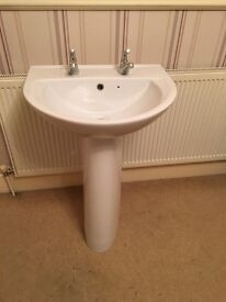 White porcelain sink and pedestal with chrome taps