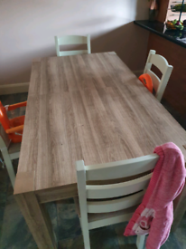 Solid Wood Table seats 6 (extends to seat 8) chairs not included