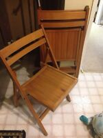 Three wooden folding chairs
