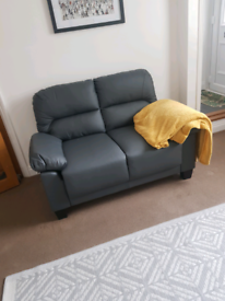 Brand New 2 seater Grey leather sofa