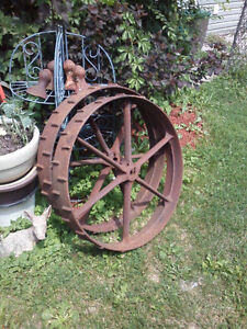 Pair of vintage cast farm wheels