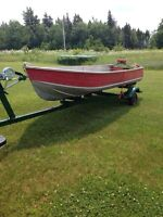 14 foot aluminum boat and trailer located outside of AMHERST