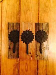 Flower hook on barn board