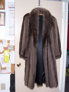 Woman's real raccoon fur coat with hat