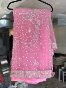 Beautiful Baby Pink Net Sari with Silver Embroidery