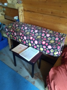 A piano, Roland HP 137R with chair, stand and books in Enderby