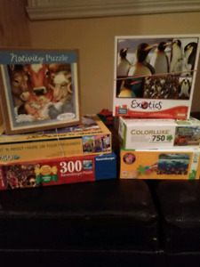 6 assorted jigsaw puzzles