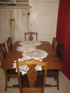 Duncan Phyfe style table and six antique chairs