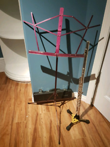 Flute, stand, music stand and sheet music