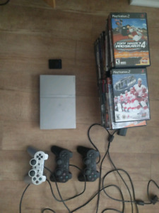 Playstation 2 (PS2) Slim Silver + 3 controllers and games