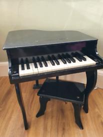 Childrens mini grand piano