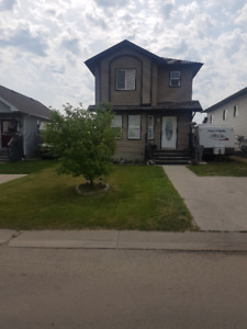 HUGE YARD, BACKING ONTO PLAYGROUND AND TRAILS IN WESTPOINTE!!